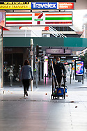 A cleaner wheels his cart up a deserted Bourke Street footpath this afternoon in Melbourne after lockdown was extended for another 7 days on the day it enters 6th day of the state wide COVID-19 lockdown that has been placed on the State of Victoria. (Photo by Michael Currie/Speed Media)