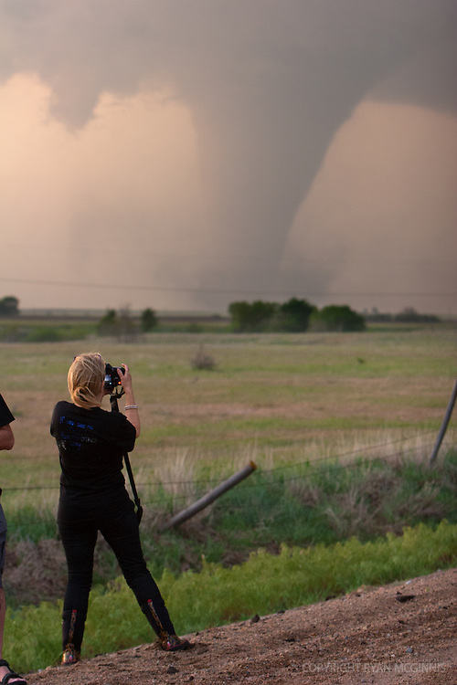 A storm chaser photographs a tornado near Rozel, Kansas, May 18. 2013.