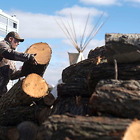 Regis Ferland helps unload a donation of firewood to the DAPL protest camp in Standing Rock, ND Wednesday. The fire wood was trucked in from the Spirit Lake tribe by Denver Littlewind to help cope with the colder weather.