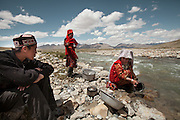Recently married Woolook Bu (R) and her husband, getting water..Daily life at the Khan (chief) summer camp of Kara Jylga...Trekking through the high altitude plateau of the Little Pamir mountains (average 4200 meters) , where the Afghan Kyrgyz community live all year, on the borders of China, Tajikistan and Pakistan.