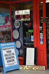 Local shop in Norwich with social distancing sign outside its door during Coronavirus lockdown, UK May 2020