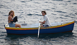 Lily James is seen with Jeremy Irvine on the set of Mamma Mia 2, which is currently filming on the Croatian island of Vis.<br /> <br /> 12 September 2017.<br /> <br /> Please byline: Vantagenews.com
