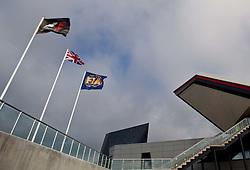 09.07.2011, Silverstone Circuit, Silverstone, GBR, F1, Großer Preis von Großbritannien, Silverstone, im Bild die Fahnen der Formula 1, Großbritanniens und der Fia mit einem Teil des neuen Hauptgebäudes in der sich die Boxen befinden, Tilt and Shift // The flags of the Formula 1, Great Britain and the FIA with a part of the new main building in which the boxes are, Tilt and Shift. during the Formula One Championships 2011 British Grand Prix held at the Silverstone Circuit, Northamptonshire, United Kingdom, 2011-07-09, EXPA Pictures © 2011, PhotoCredit: EXPA/ J. Feichter