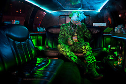 Nov. 8. 2016, in Oakland, California, U.S. - MIKE ''BIG MIKE'' BARNES takes a celebratory puff from his pipe in his privately owned ''420 Limo'' at an election party at The New Parish club, hosted by the Berkeley Patients Group for proposition 64. Prop 64 legalizes and taxes the recreational use of marijuana in California. <br /> (Credit Image: © Andrew Seng/Sacramento Bee/ZUMAPRESS.com)