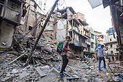 KATHMANDU, NEPAL - APRIL 26: (CHINA OUT)<br /> <br /> Two man pass by the ruins on April 26, 2105 in Kathmandu, Nepal. A 8.1-magnitude earthquake struck Nepal on Saturday and the earthquake felt in southeast China\'s Tibet Autonomous Region which brought some houses into collapse. While another 7.1-magnitude earthquake hit the county again the following day afternoon. Chinese government sent out Sichuan Rescue Team, the only one national emergency medical rescue team who could settle camps above an altitude of 3500 meters, to Nepal to support local rescue work and international assistance were also sent to the disaster areas. The earthquake had caused at least 3218 people to death and parts of Chinese visitors were detained in Nepal by Monday morning. <br /> ©Exclusivepix Media