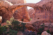 Hikers at Double O Arch, Devils Garden, Arches National Park, Moab, Utah.