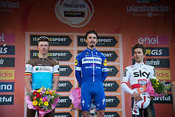 March 23, 2019 - Sanremo, Sanremo, Italy - Julian Alaphilippe (C) of the Deceuninck team, winner with Oliver Naesen of AG2R La Mondiale (L) second and Michal Kwiatkowski of Team Sky, third (R), seen on the podium of the 110th edition of Milan - Sanremo, cycling race. (Credit Image: © Diego Puletto/SOPA Images via ZUMA Wire)