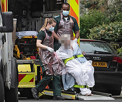 **Patients face has been pixelated to hide identity**<br /> © Licensed to London News Pictures. 13/04/2020. London, UK. A patient being transported in to an Ambulance in Maida Vale, London by ambulance workers in PPE (personal protective equipment), during a pandemic outbreak of the Coronavirus COVID-19 disease. The public have been told they can only leave their homes when absolutely essential, in an attempt to fight the spread of coronavirus COVID-19 disease. Photo credit: Ben Cawthra/LNP