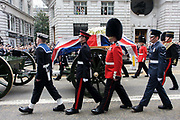 Draped in the union flag and mounted on a gun carriage, the coffin of ex-British Prime Minister Baroness Margaret Thatcher's coffin travels along Fleet Street towards St Paul's Cathedral in London, England. Afforded a ceremonial funeral with military honours, not seen since the death of Winston Churchill in 1965, family and 2,000 VIP guests (incl Queen Elizabeth) await her cortege. Margaret Hilda Thatcher, Baroness Thatcher (1925 - 2013) was a British politician who was the Prime Minister of the United Kingdom from 1979 to 1990 and the Leader of the Conservative Party from 1975 to 1990, the longest-serving British Prime Minister of the 20th century and the only woman to have held the office to date.