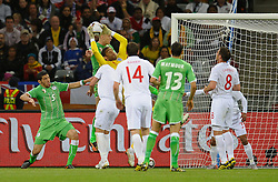 18.01.2010, Green Point Stadium, Cape Town, RSA, FIFA WM 2010, England (ENG) vs Algeria (ALG), im Bild David James of England claims the ball under pressure from an Algerain corner. EXPA Pictures © 2010, PhotoCredit: EXPA/ IPS/ Marc Atkins / SPORTIDA PHOTO AGENCY