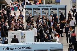 © Licensed to London News Pictures. 18/04/2019. London, UK. People on Waterloo station concourse travelling on Maundy Thursday for Easter bank holiday weekend. Millions are expected to travel by rail and passengers will face disruption as Network Rail carries out engineering work. According to the Met Office the temperatures over the Easter Weekend is likely to soar to as high as 22 degrees celsius. Photo credit: Dinendra Haria/LNP