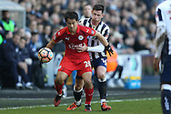 Shinji Okazaki of Leicester City holds back Calum Butcher of Millwall. The Emirates FA Cup 5th round match, Millwall v Leicester City at The Den in London on Saturday 18th February 2017.<br /> pic by John Patrick Fletcher, Andrew Orchard sports photography.