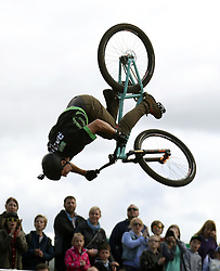 Professional freestyle MTB rider Tom Cardy performs for the crowds during the Royal Highland Show in Edinburgh.