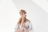 Mature spiritual woman wearing headphones.