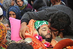 October 12, 2017 - Shopian, Jammu and Kashmir, India - (EDITORS NOTE: Image depicts death.) Thousands of people gathered for the funeral procession of LeT (Lashkar-i-Toiba) commander Waseem Shah at his ancestral village heff shirmal of district shopian, Waseem got killed in an encounter with Government security forces at Litter area of District Pulwama of South Kashmir some 47 Kilometers Appx. from Srinagar (Credit Image: © Muzamil Bhat/Pacific Press via ZUMA Wire)