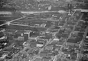 """Ackroyd 01907-3. """"aerials of northwest business district including Broadway and Burnside bridges. December 14, 1949"""" (NW Portland, Pearl District, Old Town)"""