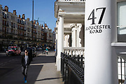 Traditional painted house numbers on columns of homes on Gloucester Road in Knightsbridge. In a selected few boroughs of West London, wealth has changed over the last couple of decades. Traditionally wealthy parts of town, have developed into new affluent playgrounds of the super rich. With influxes of foreign money in particular from the Middle-East. The UK capital is home to more multimillionaires than any other city in the world according to recent figures. Boasting a staggering 4,224 'ultra-high net worth' residents - people with a net worth of more than $30million, or £19.2million.. London, England, UK.