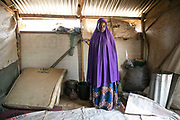 Kakahaijja, 18, stands inside her room in an IDP camp in Maiduguri, Nigeria, April 20, 2019. Kakahaijja said she was persuaded by her brother who joined Boko Haram to marry a fighter, and left home in Konduga Local Government with him and his friend in 2015. She was raped by a fighter upon arrival at the Sambisa Forest, then brought to another man to marry. She spent two years in the forest before being rescued by the Nigerian Army.
