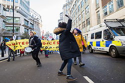 London, UK. 22nd January, 2019. Receptionists, security guards and cleaners at the Ministry of Justice (MoJ) represented by United Voices of the World (UVW) and support staff at the Department for Business, Energy and Industrial Strategy (BEIS) represented by the Public and Commercial Services (PCS) union march around Westminster after beginning a coordinated strike for the London Living Wage of £10.55 per hour and parity of sick pay and annual leave allowance with civil servants.