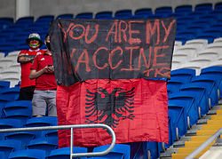 """CARDIFF, WALES - Saturday, June 5, 2021: An Albania supporter with a banner """"You are my vaccine"""" during an International Friendly between Wales and Albania at the Cardiff City Stadium in their game before the UEFA Euro 2020 tournament. (Pic by David Rawcliffe/Propaganda)"""
