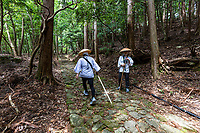 "The Shikoku pilgrimage route is one of the few circular-shaped pilgrimages in the world. It includes 88 official temples and numerous other sacred sites asscoaited with Kobo Daishi. Walking henro pilgrims take some 6 weeks to complete the journey - the entire route is about 1200 kilometers long which allows one to experience the natural surroundings of Shikoku and presents pilgrims with numerous opportunities to mix with the local people. Henro pilgrims undertake this trip for various reasons but the most underlying one is to ""walk with Kobo Daishi"" as it is believed that Kukai is accompanying them on this journey."