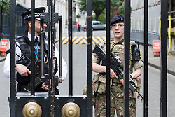 © Licensed to London News Pictures. 27/05/2017. LONDON, UK.  Armed soldiers provide additional security with police officers outside Downing Street in Westminster today following the risk of a terrorist attack on the capital.  Photo credit: Vickie Flores/LNP