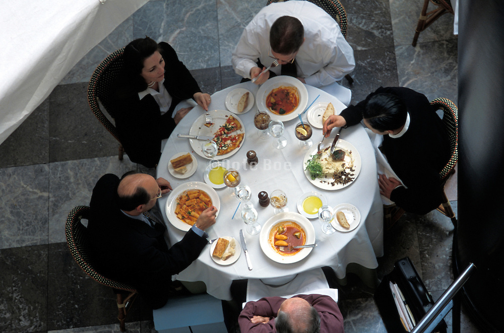 People eating together at a business meeting