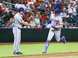 June 14, 2018 - Phoenix, AZ, U.S. - PHOENIX, AZ - JUNE 14: New York Mets center fielder Brandon Nimmo (9) gives a high five to New York Mets third base coach Glenn Sherlock (53) during the MLB baseball game between the Arizona Diamondbacks and the New York Mets on June 14, 2018 at Chase Field in Phoenix, AZ (Photo by Adam Bow/Icon Sportswire) (Credit Image: © Adam Bow/Icon SMI via ZUMA Press)