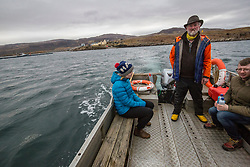 Resident Rebecca Munro and  Donald Munro, who has been the Ulva boatman for decades. Feature on the community on the island of Ulva, who have been awarded £4.4m in funding for their island buyout.