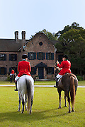 Mounted Fox Hunters wait for the start of the hunt in front of the plantation house at Middleton Place plantation in Charleston, SC.