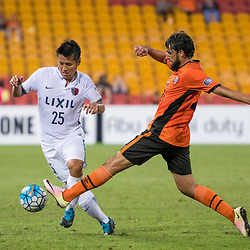 BRISBANE, AUSTRALIA - APRIL 12: Endo Yasushi of Kashima is tackled by Thomas Broich of the Roar during the Asian Champions League Group Stage match between the Brisbane Roar and Kashima Antlers at Suncorp Stadium on April 12, 2017 in Brisbane, Australia. (Photo by Patrick Kearney/Brisbane Roar)