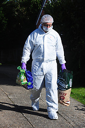 © Licensed to London News Pictures. 29/09/2018<br /> HADLOW, UK.<br /> Forensics officer collecting dog food from 24 Carpenters Lane for the pet dog.<br /> A murder investigation has been launched in Hadlow,Kent after the deaths of two women at Carpenters Lane. A 28 year old man has been arrested on suspicion of murder after three people suffered serious injuries. Police forensic officers are at the scene inside two properties 26 and 24 Carpenters Lane.<br /> Photo credit: Grant Falvey/LNP