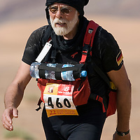 26 March 2007:  #460 Volker Voss of Germany walks toward the end of the second stage (21.7 miles) of the 22nd Marathon des Sables between Khermou and jebel El Otfal. The Marathon des Sables is a 6 days and 151 miles endurance race with food self sufficiency across the Sahara Desert in Morocco. Each participant must carry his, or her, own backpack containing food, sleeping gear and other material.