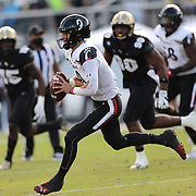 ORLANDO, FL - NOVEMBER 21:  Desmond Ridder #9 of the Cincinnati Bearcats scrambles against the Central Florida Knights at Bounce House-FBC Mortgage Field on November 21, 2020 in Orlando, Florida. (Photo by Alex Menendez/Getty Images) *** Local Caption *** Desmond Ridder