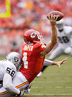 KANSAS CITY, MO - SEPTEMBER 14:   Tyler Thigpen #4 of the Kansas City Chiefs is tackled by Derrick Burgess #56 of the Oakland Raiders at Arrowhead Stadium on September 14, 2008 in Kansas City, Missouri.  The Raiders defeated the Chiefs 23-8.  (Photo by Wesley Hitt/Getty Images) *** Local Caption *** Tyler Thigpen; Derrick Burgess Sports photography by Wesley Hitt photography with images from the NFL, NCAA and Arkansas Razorbacks.  Hitt photography in based in Fayetteville, Arkansas where he shoots Commercial Photography, Editorial Photography, Advertising Photography, Stock Photography and People Photography