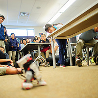 050714       Adron Gardner<br /> <br /> Tsehootsooi Middle School students watch as a autonomous Star Wars R2D2 robot explores the floor of Ms. White's classroom in Fort Defiance Wednesday.