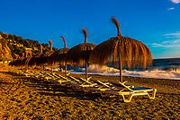 Palapas, Playa de la Herradura (beach), Granada Province, Andalusia, Spain.