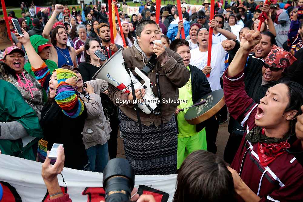 Caro Gonzales of the International Indigenous Youth Council speaks to a crowd of supporters during a rally against the Dakota Access oil pipeline on the North Dakota capitol grounds on September 9, 2016. Bismarck, North Dakota, United States.