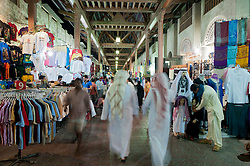 Night view of busy souq or market in Bur Dubai UAE Middle East