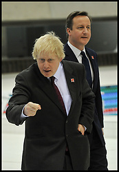 Britain's Prime Minister David Cameron and the London Mayor Boris Johnson look around the Olympic Aquatic Centre at the 2012 Olympic Games site  London. As the London Olympics countdown enters its final 200 days, Monday January 9, 2012. Photo By Andrew Parsons/ i-Images