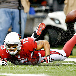 Sep 22, 2013; New Orleans, LA, USA; Arizona Cardinals wide receiver Michael Floyd (15) hits the turf attempting to make a reception against the New Orleans Saints during a game at Mercedes-Benz Superdome. The Saints defeated the Cardinals 31-7. Mandatory Credit: Derick E. Hingle-USA TODAY Sports