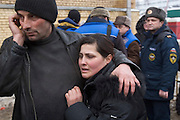 Moscow, Russia, 23/02/2006..A weeping woman is led away from Baumanskii Marrket in eastern Moscow after the market roof collapsed, apparently under the weight of snow, killing many people.
