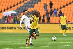 South Africa: Johannesburg: Bafana Bafana player Kamohelo Mokotjo battle for the ball with Seychelles player Karl Hopprich during the Africa Cup Of Nations qualifiers at FNB stadium, Gauteng.<br />Picture: Itumeleng English/African News Agency (ANA)