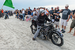 Joe Gimpel on his 1928 BMW R52 passes through the start on the sands of Daytona Beach at the beginning of stage 1 of the Motorcycle Cannonball Cross-Country Endurance Run, which on this day ran from Daytona Beach to Lake City, FL., USA. Friday, September 5, 2014.  Photography ©2014 Michael Lichter.