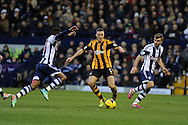 James Chester of Hull city ©  in action. Barclays Premier league, West Bromwich Albion v Hull city at the Hawthorns in West Bromwich, England on Saturday 21st Dec 2013. pic by Andrew Orchard, Andrew Orchard sports photography.
