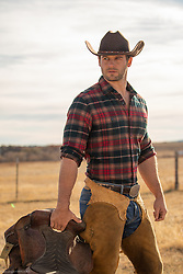 hot rugged cowboy in chaps on a ranch