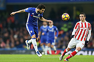 Cesc Fabregas of Chelsea heading the ball. Premier league match, Chelsea v Stoke city at Stamford Bridge in London on Saturday 31st December 2016.<br /> pic by John Patrick Fletcher, Andrew Orchard sports photography.