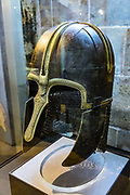 """Made of iron and copper alloy, the well-preserved York Helmet dates from AD 750-775. The owner's name was inscribed as OSHERE, """"Warrior of the Royal House of Os,"""" of northern England. The Yorkshire Museum houses some of the finest collections of archaeological and geological finds in Europe, from prehistory to the city's medieval splendour. The historic walled city of York lies at the confluence of rivers Ouse and Foss in North Yorkshire, England, United Kingdom, Europe. York is renowned for its exquisite architecture, tangle of quaint cobbled streets, iconic York Minster, the longest medieval town walls in England, and a wealth of visitor attractions. Founded by the Romans as Eboracum in 71 AD, it became capital of the Roman province of Britannia Inferior, and later of the kingdoms of Northumbria and Jorvik (mostly controlled by Vikings 875 to 954). In the Middle Ages, York grew as a major wool trading centre and became the capital of the northern ecclesiastical province of the Church of England, to this day. In the 1800s, York became a hub of the railway network and center for confectionery manufacturing. The University of York, health services, and tourism have become major employers."""