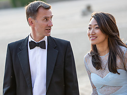 """© Licensed to London News Pictures . Oxfordshire , UK . FILE PICTURE DATED 12/07/2018 of British Foriegn Secretary JEREMY HUNT and his wife LUCIA GUO , at Blenheim Palace , during a visit by US President Donald Trump . Hunt has mistakenly referred to his Chinese wife as """"Japanese"""" during an official visit to China . Photo credit: Joel Goodman/LNP"""