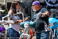 Jody and Dave Perewitz judging entries in their Perewitz Paint annual bike show at the Iron Horse Saloon during the Sturgis Black Hills Motorcycle Rally. SD, USA. Wednesday, August 7, 2019. Photography ©2019 Michael Lichter.